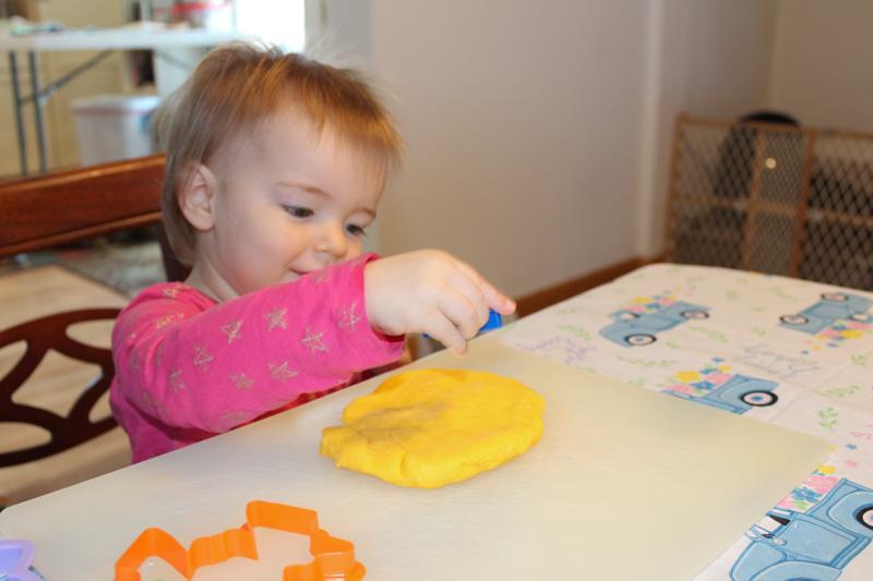 girl poking the dough