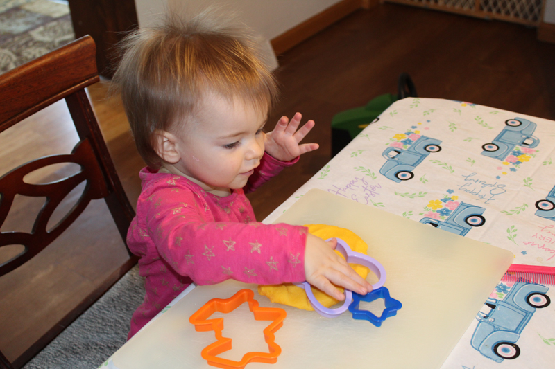 girl playing with gluten free playdoh and cookie cutters