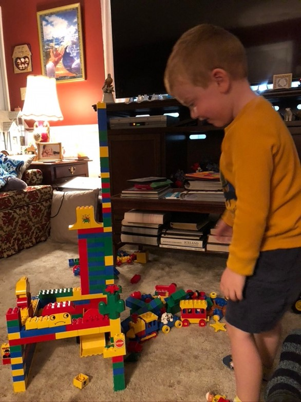 little boy playing with legos and color patterns