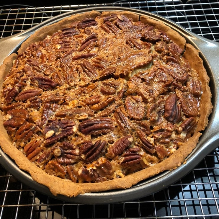 baked pecan pie on a cooling rack