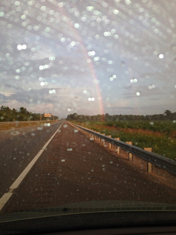 rainbow over a highway to symbolize a miracle
