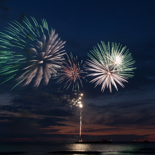 fireworks at dusk at the beach